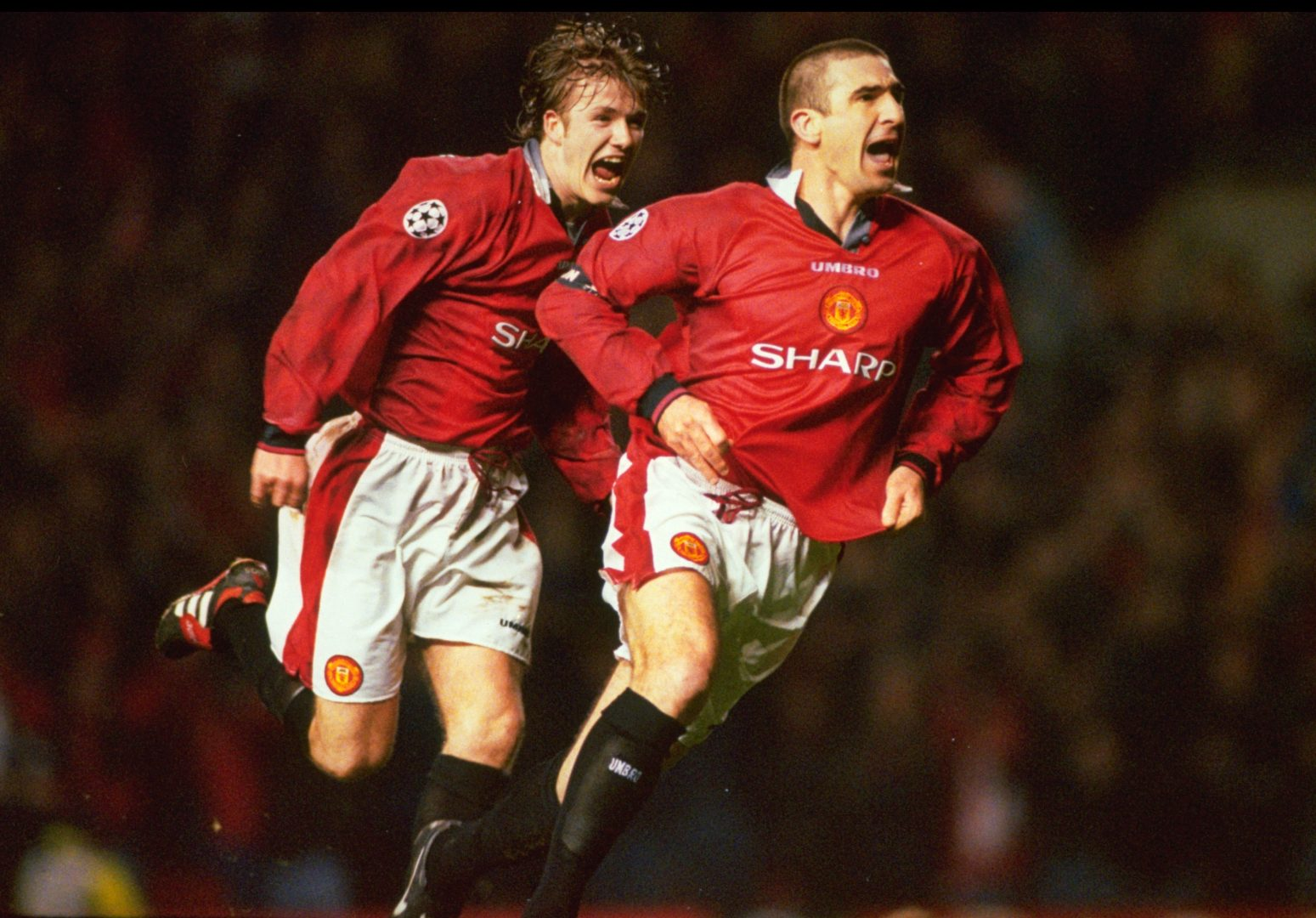 Eric Cantona celebrates scoring a goal with David Beckham. Old Trafford, 1996