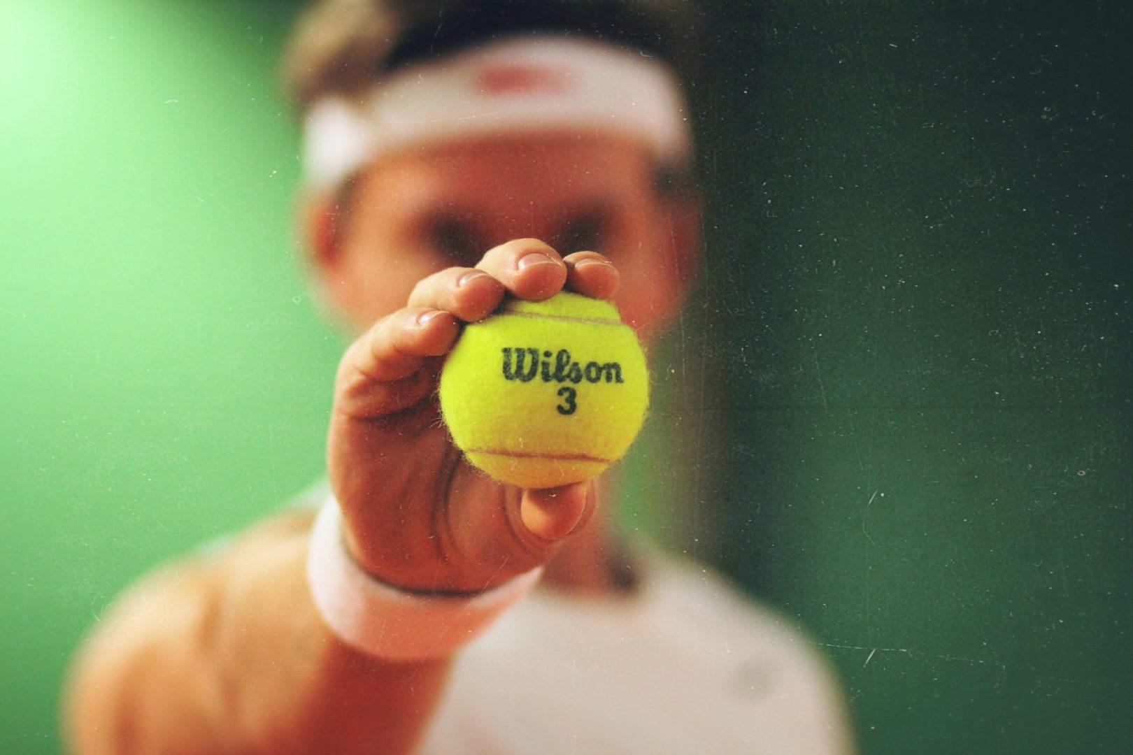 Man holding a tennis ball