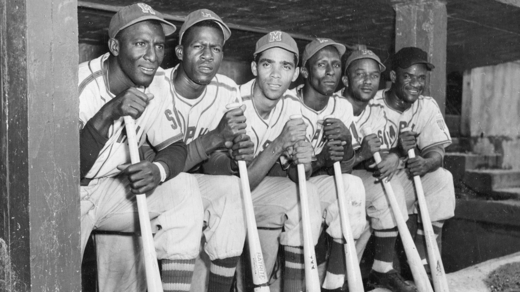 Photographic print by the Hook Brothers of a group of Cuban baseball players from the Negro League Red Sox in the dugout together during a home game, Memphis, Tennessee, circa 1951. Among the players are Carlos Colas, far left, and Pedro Formental, far right. (Photo by Transcendental Graphics/Getty Images)