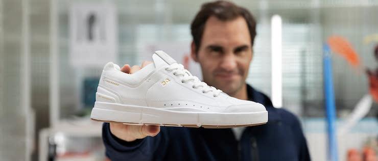 Roger Federer holding the ROGER Centre Court shoe