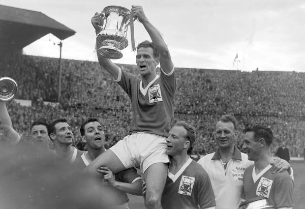 Football - 1959 FA Cup Final - Nottingham Forest 2 Luton Town 1 Forest captain Jack Burkitt lifts the trophy as he is chaired by team mates Jeff Whitefoot (right) and Tommy Wilson (left) at Wembley. 02/05/1959